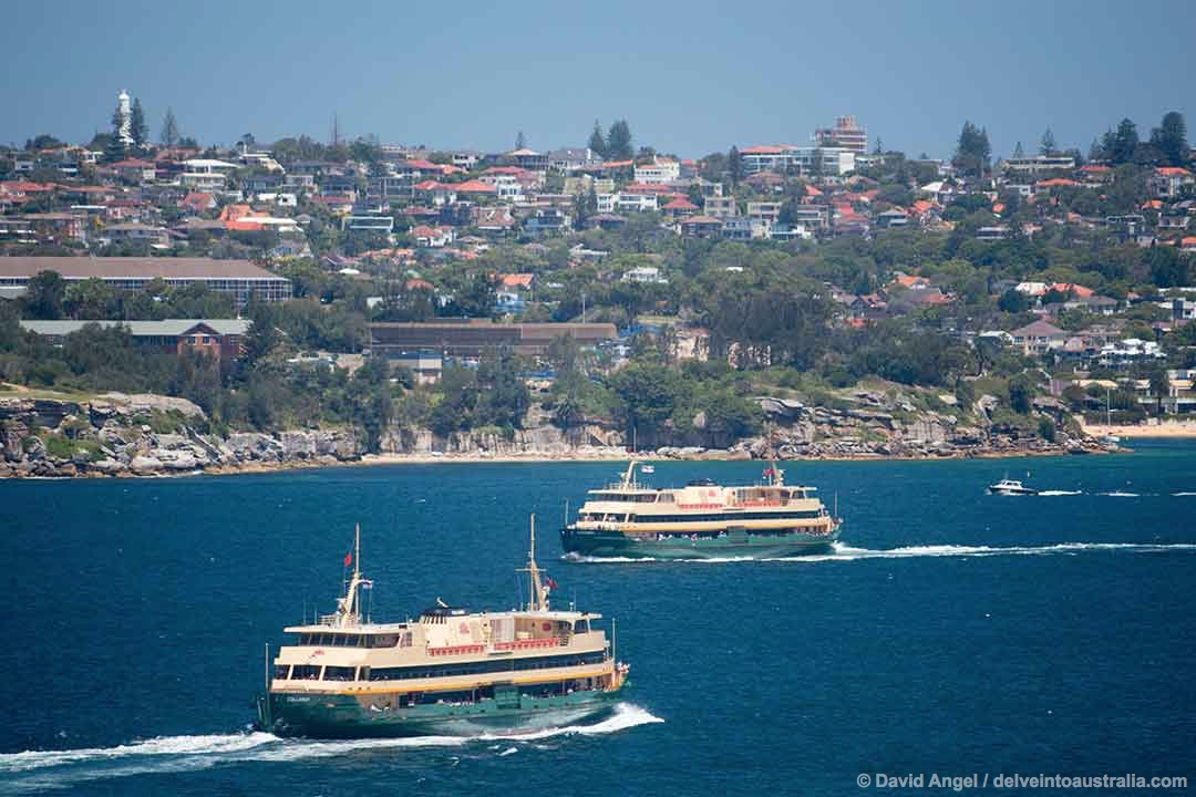 Image of two ferries crossing in Sydney Harbour