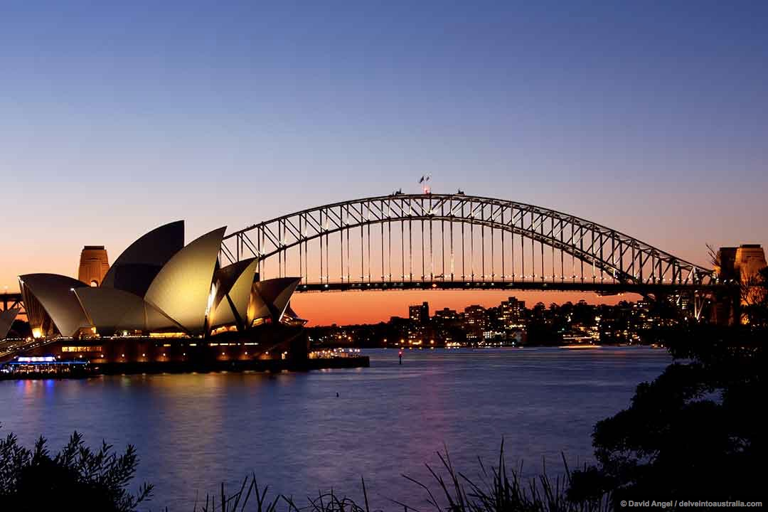 Image of Sydney Opera House and Harbour Bridge at Sunset from Mrs Macquarie's Point